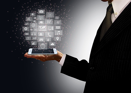 Businessman holding a smartphone with information technology holographic icons